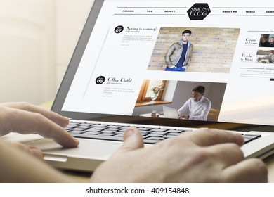 online business concept: man using a laptop with fashion blog on the screen. Screen graphics are made up.
