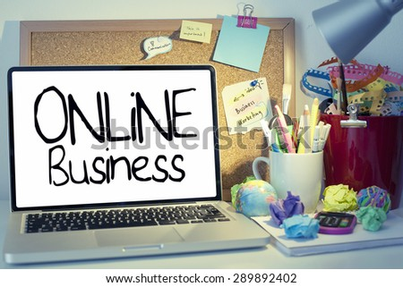 Online Business / Internet business concept note on laptop in office