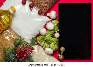 Online christmas shopping. Set of various groceries. Cereals, sunflower oil, canned food, mushrooms, rosemary. Online store. Winter holiday sales.
