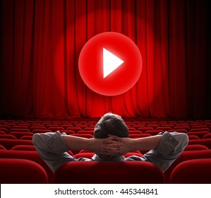 online cinema screen with red curtain and play media button in center
