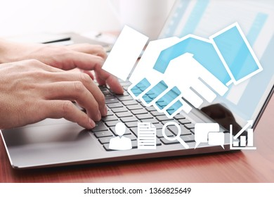 Online contract concept. Businessman using laptop for contacting partner.