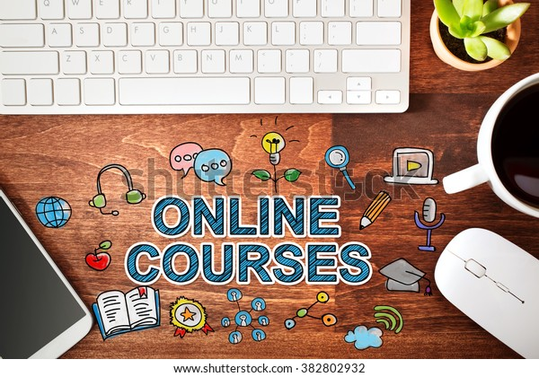 Online Courses concept with workstation on a wooden desk