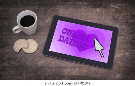 Online dating on a tablet - concept of love, purple
