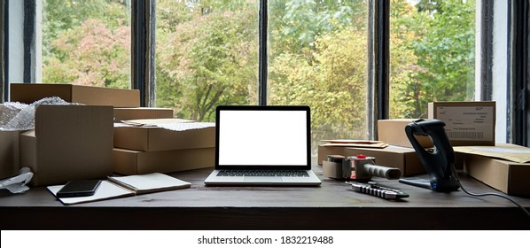 Online ecommerce store mockup, dropshipping business website concept. Table with laptop computer mock up blank white screen and shipping boxes, retail marketplace, warehouse delivery background.