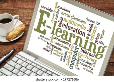 online education concept - e-learning word cloud on a laptop with a cup of coffee