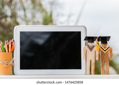 Online education learning concept, university knowledge achievement for study abroad international, alternative studying idea.Models graduation celebration with tablet pencils box, copy space for text