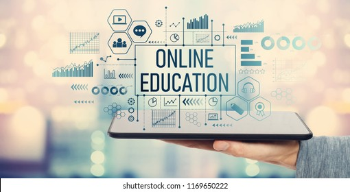 Online education with man holding a tablet computer