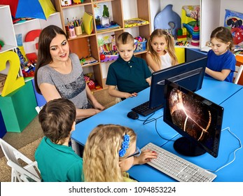 Online education student computer class . Teacher with children used combines technologies e-learning as alternative to classical training. Astronomy virtual science lesson. Features of working with