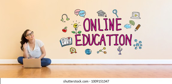 Online Education text with young woman using a laptop computer on floor
