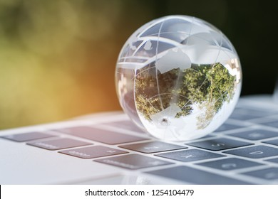 Online E-Learning education by Technology concept : Australia Educational knowledge learning study abroad international Ideas. Glass earth globe on laptop keyboard, Studies from anywhere anytime