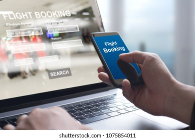 Online flight booking. Airline Internet application on smart phone. Man using mobile smartphone and website searching on laptop computer for ticket booking and online payment with airport background