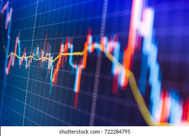 Online forex data. Analysing stock market data on a monitor. Stock diagram on the screen. Blue screen of finance data. World economics graph. Market analysis for variation report of share price.