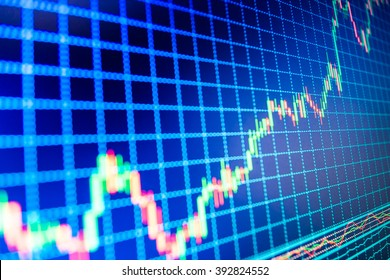 Online forex data. Share price quotes. Candle stick graph chart of stock market investment trading. World economics graph. Blue background with stock chart. Macro close-up. Finance concept.