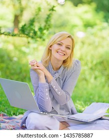 Online freelance career concept. Pleasant occupation. Guide starting freelance career. Business lady freelance work outdoors. Become successful freelancer. Woman with laptop sit on rug grass meadow.