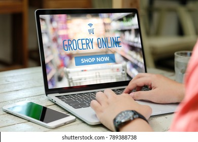 Online grocery order, Hands typing laptop computer with grocery shopping online on screen background, e commerce, business and technology, lifestyle concept