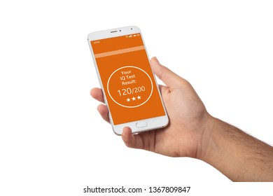 Online IQ test. Man hand holding a mobile phone, Intelligence test result text on screen, isolated against white background.