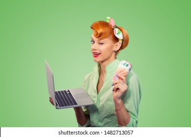 On-line job, internet lottery winner. Closeup red head beautiful young woman girl excited smiling pinup girl in button shirt holding pc and euro bills looking at camera retro vintage style on green