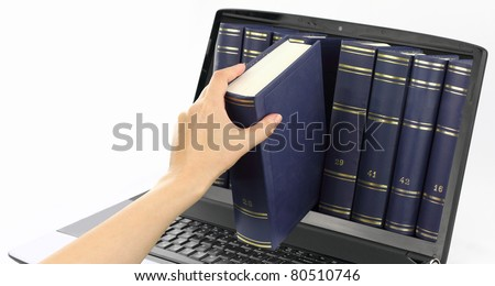 Online learn library. Laptop computer with books, isolated on white