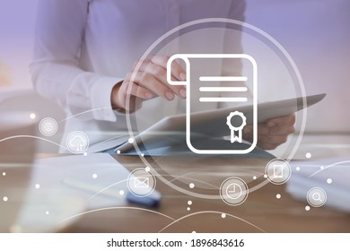 Online learning concept. Diploma with other icons on foreground and woman using tablet, closeup - Shutterstock ID 1896843616