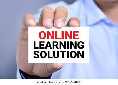 ONLINE LEARNING SOLUTION, mesasge on the card shown by a man