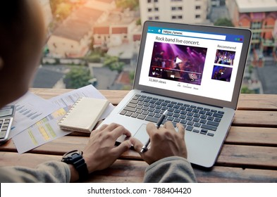 Online live streaming concept.Man watching live video on website or social network