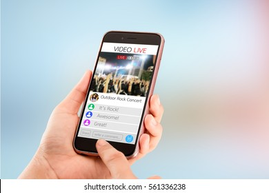 Online live streaming.Female hands using smart phone on blurred abstract background