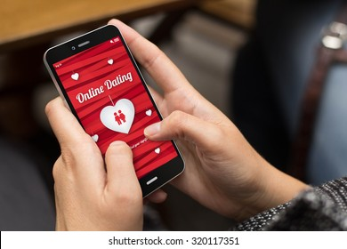 online love concept: girl using a digital generated phone with dating site on the screen. All screen graphics are made up.
