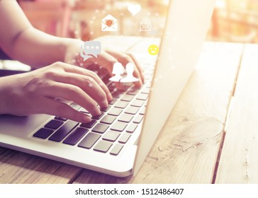 Online marketing concept. Hand of businesswoman using laptop computer with online live chat chatting on application communication digital media website and social network.