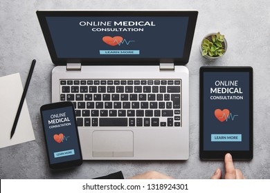 Online medical consultation concept on laptop, tablet and smartphone screen over gray table. Flat lay