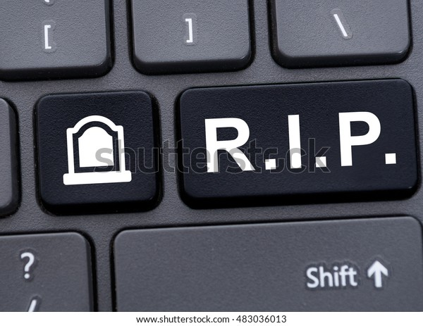 Online memorial concept with R.I.P. abbreviation button on computer keyboard
