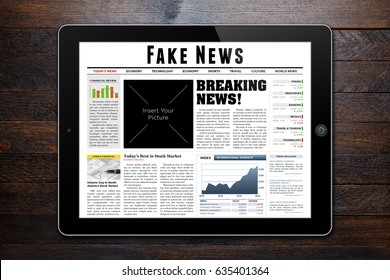 Online news on tablet showing 'Fake News' as headline.