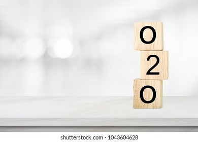 Online to offline, O2O, on wooden cube over blur background with copy space, marketing business concept
