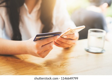 Online payment or mobile internet banking concept - Woman hands holding using smartphones for shopping and credit card making order transaction