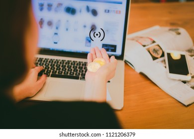 Online payment, Woman  hands holding a credit card, Bitcoins  and using smart phone laptop  for online shopping crypto currency