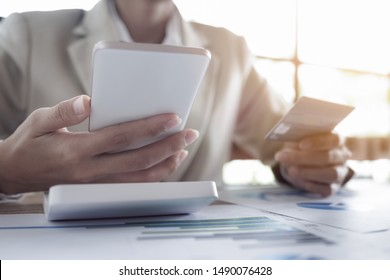 Online payment, Young Man's hands holding smart phone mobile and credit card for online shopping.