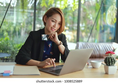 Online payment,Man and Woman  hands holding a credit card and using smart phone laptop  for online shopping