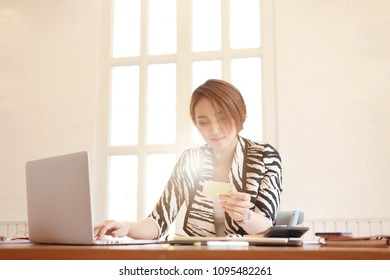 Online payment,Man and Woman  hands holding a credit card, Cash and using smart phone laptop  for online shopping