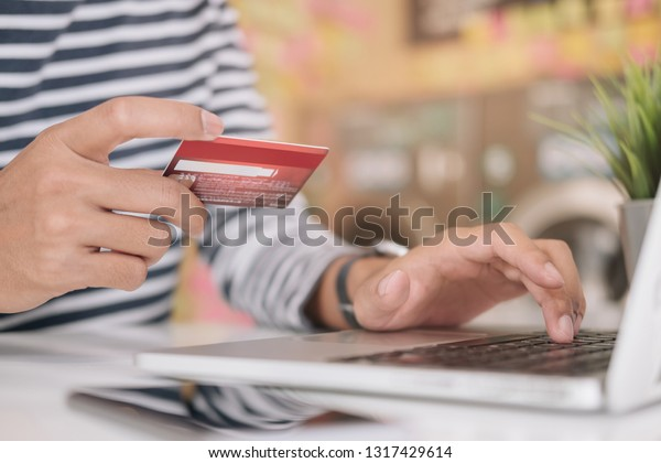 Online payment,Man's hands holding smartphone and using credit card for online shopping. Cyber Monday Concept