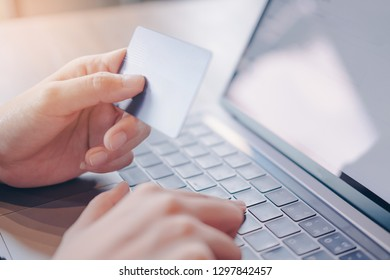 Online payment,woman's hands holding credit card  and using computer for online shopping. Cyber Monday Concept.