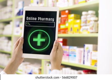 Online pharmacy concept, female pharmacist holding tablet, empty search bar on display, drugs on shelves in backround
