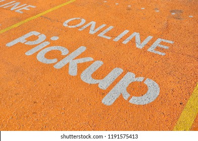 Online pickup sign painted in parking area