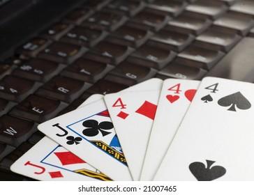 Online poker gambling concept full house on keyboard
