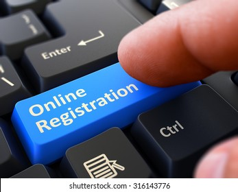 Online Registration - Written on Blue Keyboard Key. Male Hand Presses Button on Black PC Keyboard. Closeup View. Blurred Background.