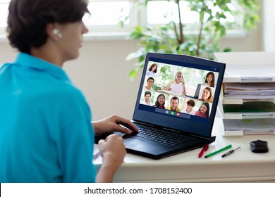 Online remote learning. High school kids with computer having video conference chat with teacher and class group. Teenager studying from home. Homeschooling during quarantine and coronavirus outbreak.