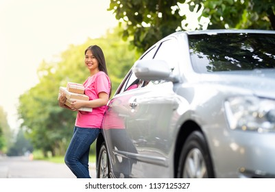 Online seller business woman holding product box for sending to customer
