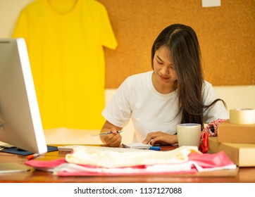 Online seller business woman writhing detail after have purchase order