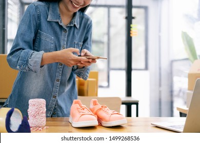 Online seller owner take a photo of product for upload to website online shop. Online Selling , Online Shopping and e-Commerce concept.