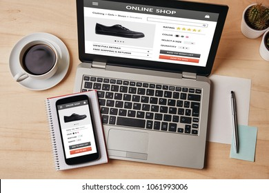 Online shop concept on laptop and smartphone screen over wooden table. All screen content is designed by me. Flat lay