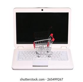 online shopping. cart on laptop isolated on white background