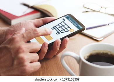 Online shopping. Shopping cart on smartphone display.